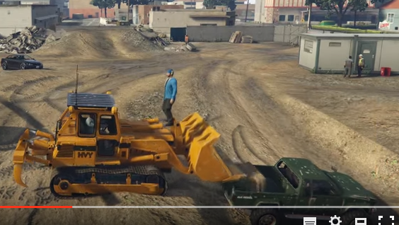 Loading hay into a truck with a bulldozer
